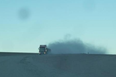 Dust clouds caused by large trucks